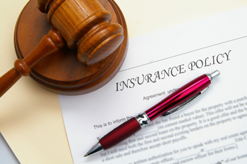 insurance policy and legal gavel with pen